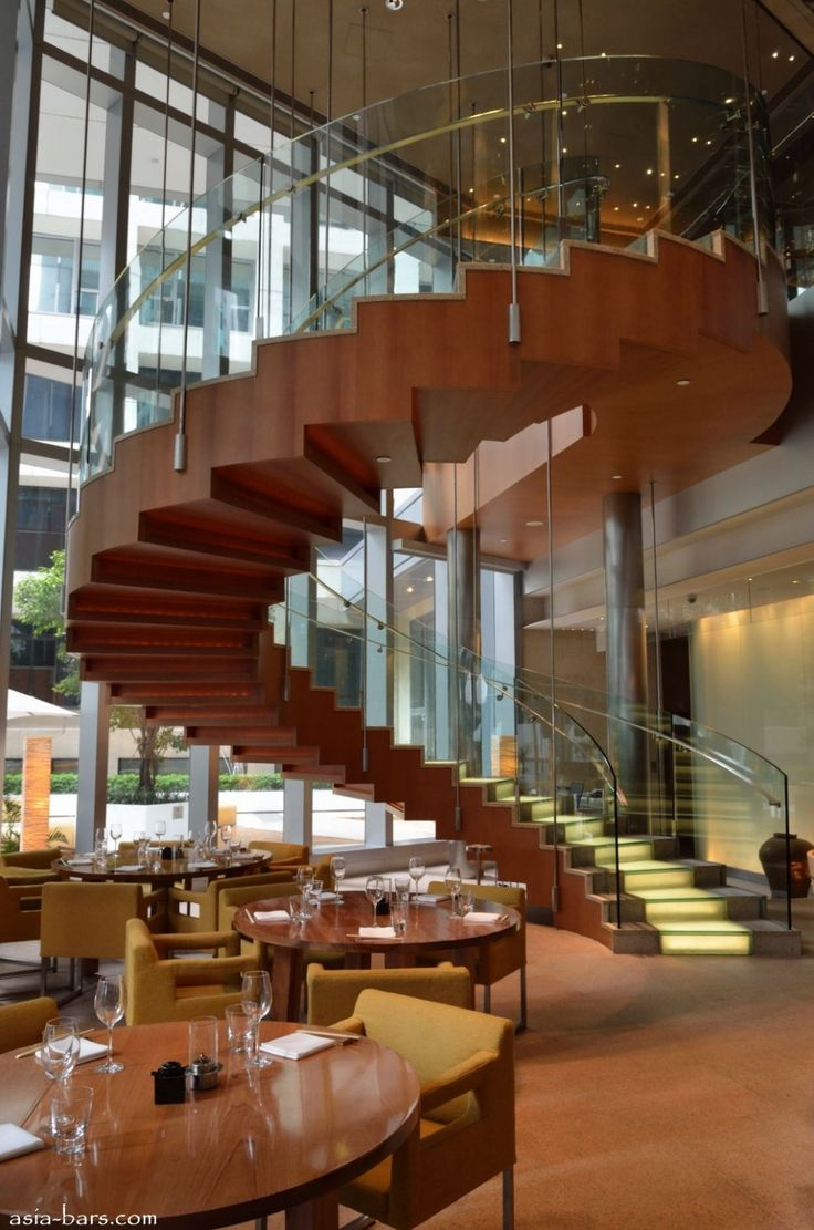 Kitchen: Marvellous Spiral Staircase Dimensions Style Perfect Wood Varnished Advanced Style Interior Design For Restaurant With Glass Mixed Metal Fences Combined Round Wooden Dining Table Set On Brown Carpet Floor Inspiration: Sensual Spiral Staircase in Contemporary Interior Designs
