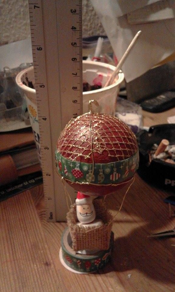 homemade hot air balloon for Santa.  styroform ball, paint, gold tulle, christistmas tape,  burlap  and goldwire