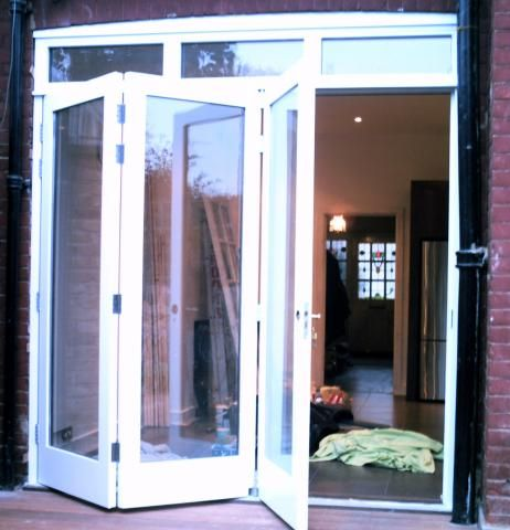 Tri fold doors out to patio hmd joinery limited house for Fold out patio doors