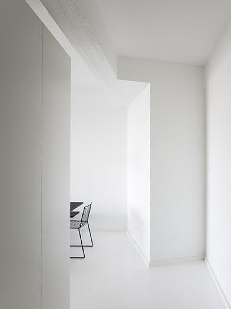All white interior inside the A House in Copenhagen by Holgaard Arkitekter.