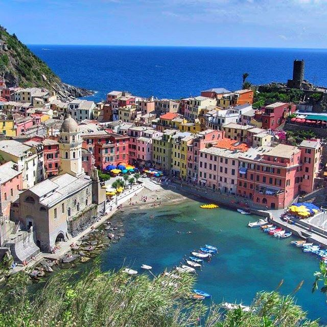 """📸: Vernazza ➡️ Possibly my favourite of the five villages and its views from the hiking trail are just breathtaking!   Check out this week's featured post for some tips on how to get to this incredible """"photo op"""" location for yourself!   www.thegirlswhowander.com  #thegirlswhowander #Vernazza #cinqueterre #Italy #ItalianRiviera #topitalyphoto #hike #hiking #beauty #travel #instatravel #photography"""