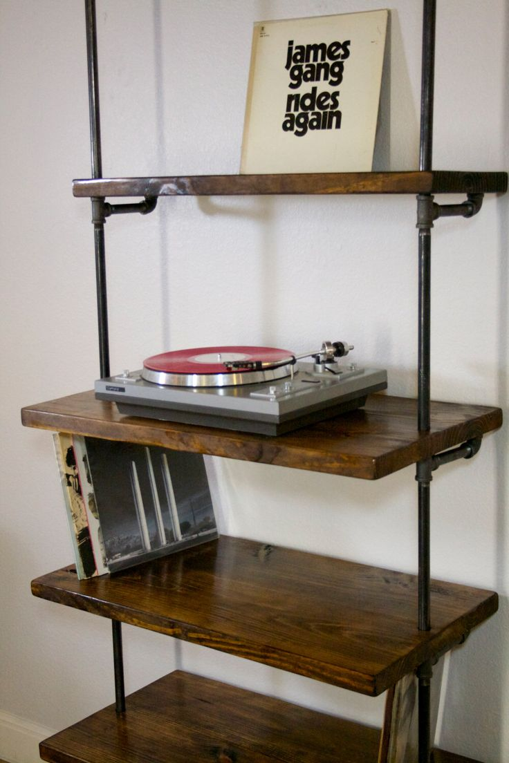 Industrial Record Shelving Unit Bookcase- Modern Record/ turntable storage shelving shelf Industrial furniture , lp record stand, lp storage by IndustrialEnvy on Etsy https://www.etsy.com/listing/227067438/industrial-record-shelving-unit-bookcase