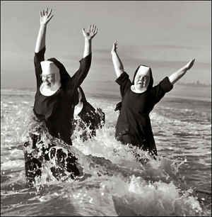 nuns playing in the ocean