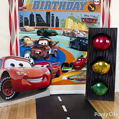 Create a Grand Prix backdrop for party pics with a DIY road and stop light! For the how-to and even more Cars party ideas, just click the pic!
