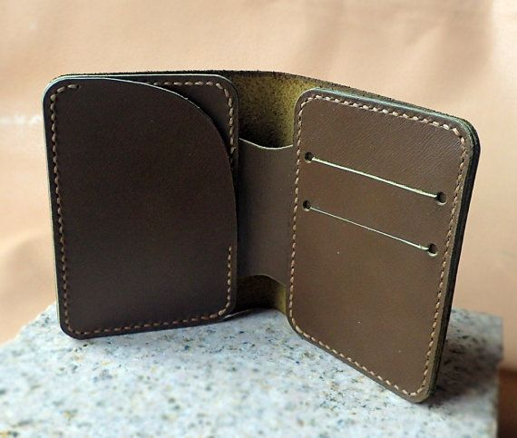 Simple leather wallet. Natural leather marsh color 9 х 11cm 2 slots for cards, 1 big slots for credit cards, checks or business cards, and 1 big pocket for money.