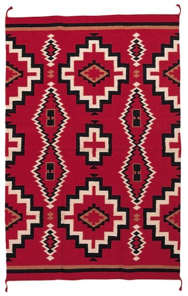 Navajo design. Wonder if this was an inspiration for the bandannas that the cowboys later wore.