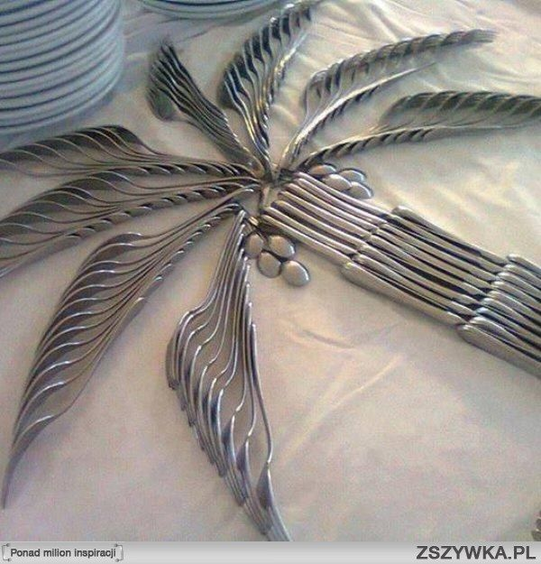Creative cutlery arrangement for a party or buffet. Palm leaves are forks, knives form the trunk and overturned spoons give the illusion of coconuts. Perfect for a tropical themed outdoor party! 3-25-14
