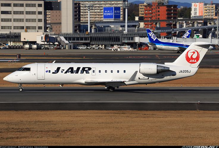 J-Air (JP) Canadair CRJ-200 JA205J aircraft, with the ''Tsurumaru=Crane circle'' livery on the airframe, skating at Japan Osaka International Airport. 15/03/2016. (J-Air=a wholly owned by JAL Japan Airlines company).