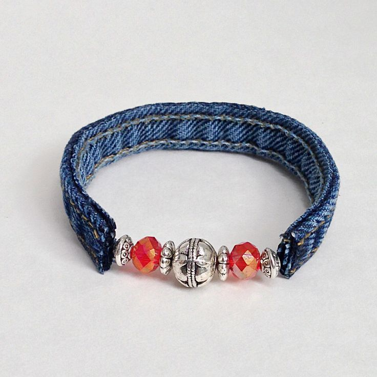 Red Beaded Denim Wrap Jeans Bracelet, Recycled Upcycled Repurposed Garnet Color Cuff Braclet, Silver Beads Denim Seams by EverydayWomenJewelry on Etsy https://www.etsy.com/listing/239818584/red-beaded-denim-wrap-jeans-bracelet