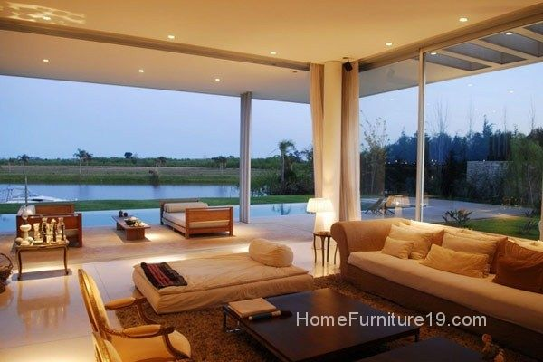 White Soft Sofa Colorful Pillows And Brown Colored Low Tables Which Are Made From Wooden Material