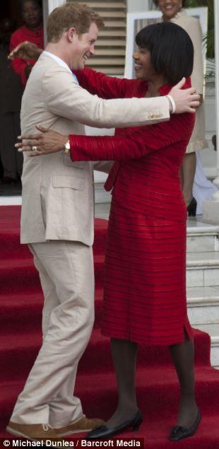 Prince Harry hugging Jamaican Premier Portia Simpson Miller