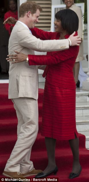 Prince Harry hugging Jamaican Premier Portia Simpson Miller. k could he be any hotter?