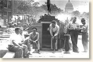 In 1924, a grateful Congress voted to give a bonus to World War I veterans - $1.25 for each day served overseas, $1.00 for each day served in the States. The catch was that payment would not be made until 1945.  However, by 1932 the nation had slipped into the dark days of the Depression and the unemployed veterans wanted their money immediately. In May of that year, some 15,000 veterans, many unemployed and destitute, descended on Washington, D.C. to demand immediate payment of their bonus.