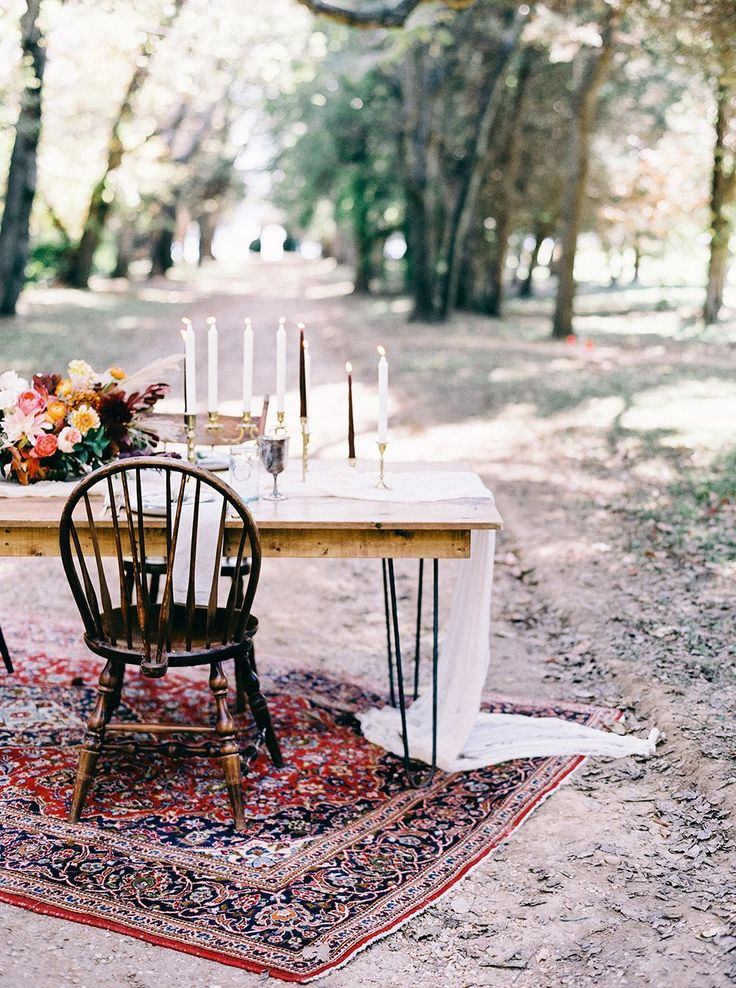 Our sleek Hairpin Farm Table, Wooden Mismatched Chairs and Atwood rug help create this super romantic head table design at a recent styled shoot at Berkeley Plantation by Tart Event Co, Amanda Burnette Florals and Nikki Santerre Photography!