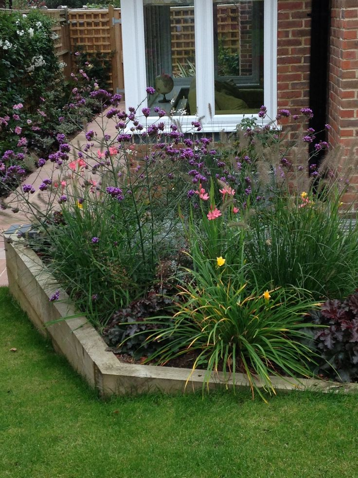 See-through plants bring interest near the house while maintaining a view of the garden.