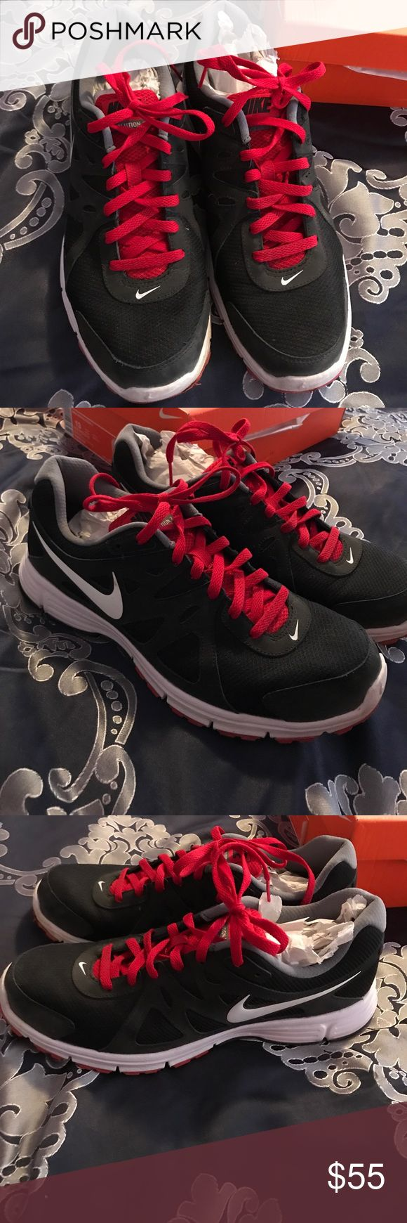Men's Nike revolution sneakers size 13 Men's Nike revolution size 13 sneakers color of sneakers are black white and varsity red with red laces. Only worn 2 times. Comes in Nike original box Nike Shoes Sneakers