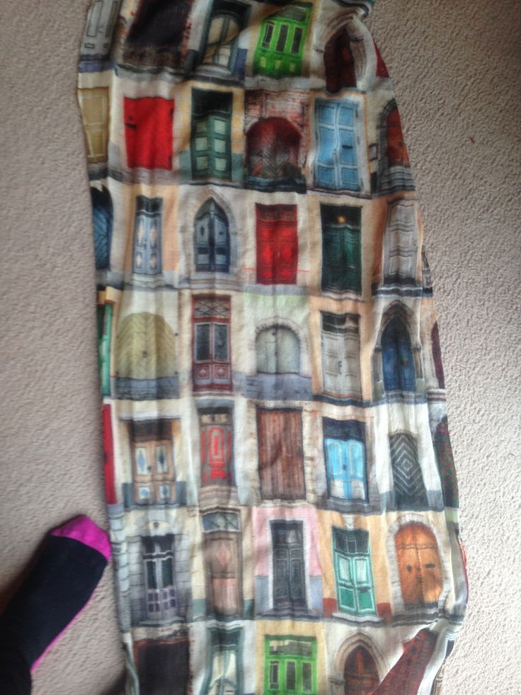 awesome scarf I found a few weeks ago, it has doors all over it, I always imagine that I can just pick any one of the doors and step through to a different city haha