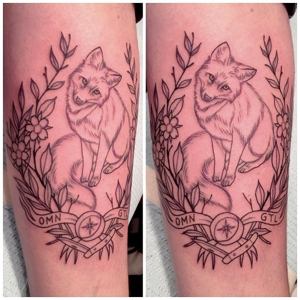 Fox tattoo. I love the foxes face.