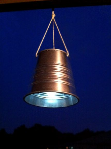 Take a solar light- remove the actual stake and cut a hole in the bottom of a small pail. Attach the two and string it up and you have a solar light for a few dollars that can hang anywhere.