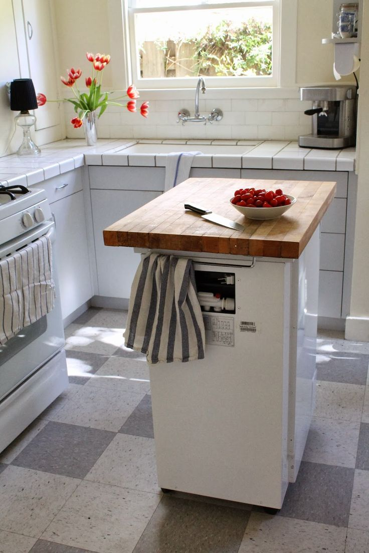 Here's an example of a dual-use piece of furniture~a dishwasher that doubles as a butcher block island. | The Vintique Object: Our Vintage Kitchen | Tiny Homes