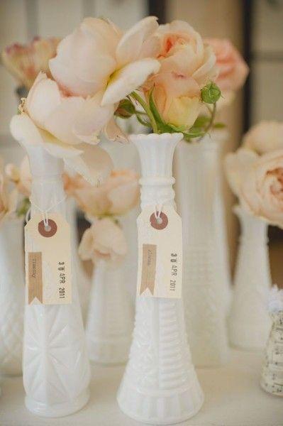 milk glass bud vases as place card holders vintage wedding idea
