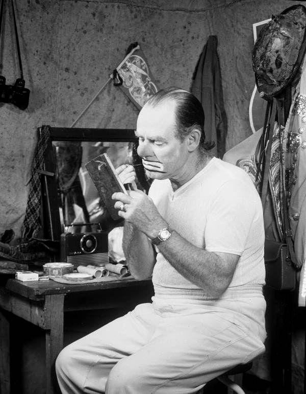 Ringling Circus clown Emmett Kelly puts on his makeup (ca. 1940).   Florida Memory