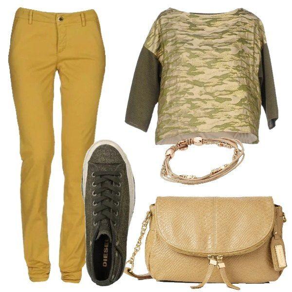 I pantaloni in cotone giallo ocra hanno la gamba diritta e le tasche a filetto. Li abbiniamo alla blusa a fantasia camouflage nel toni del verde militare con inserti dorati e le maniche a 3/4 a tinta unita verde militare. Ai piedi scarpe stringate sportive in tessuto verde militare con fili di lurex e para bianca e come borsa un modello a tracolla giallo oro a stampa pitone tono su tono con patta e decori dorati. Per finire braccialetto in pelle a vari giri con charms oro.
