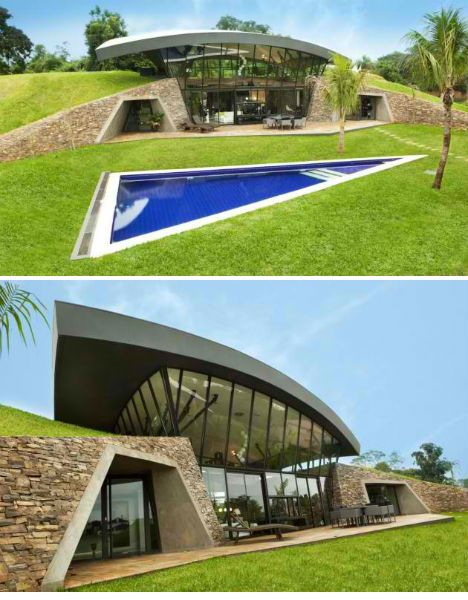 Modern Earth Shelter: Homes Built into the Hillside Rather than attempting to transcend vernacular architecture, BAUEN architecture studio has embraced its wisdom for two homes that sit side-by-side in Luque, Paraguay. The homes are thoroughly modern, but utilize an ancient earth-sheltered tradition to work in harmony with the hot, humid tropical climate of the area.