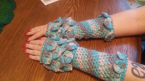 This listing is for a digital PDF PATTERN to make Dragon Scale Arm Warmers. Written in US crochet terms. Intermediate level. All pattern sales are final. NO RETURNS as this is a digital file. Supplies needed: H crochet hook and approximately 236 yds medium weight yarn.  You will be emailed a link from Etsy once your payment has cleared to download the file.