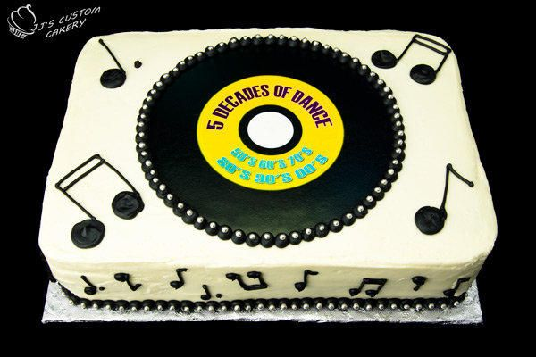 Edible Image record, with black buttercream music notes and piping,