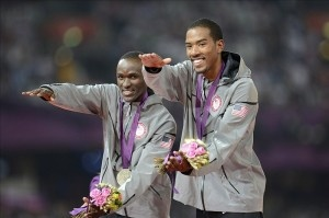 Gators Christian Taylor and Will Claye give the Gator chomp on the Olympic podium after winning Gold and Silver, respectively, in the Triple Jump.
