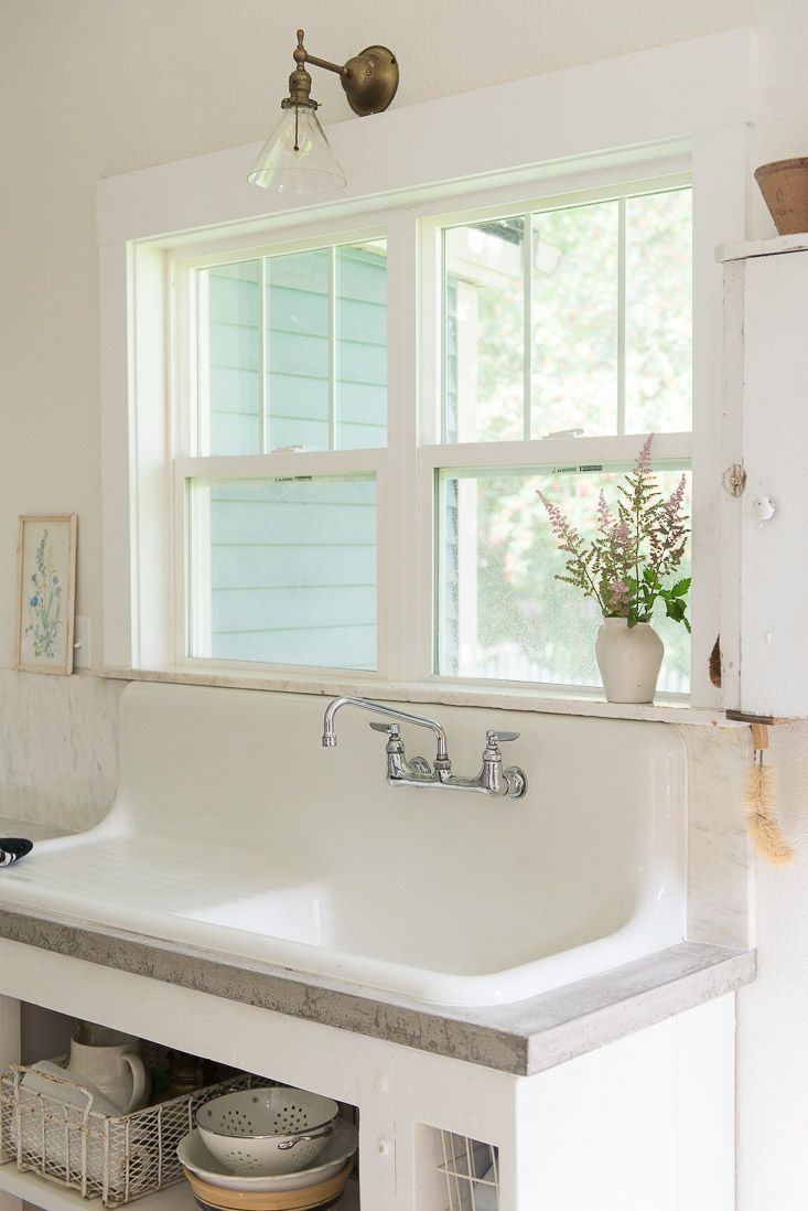 white-farmhouse-sink-concrete-countertops-budget-kitchen-remodel
