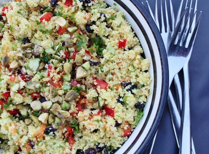 Cauliflower 'rice' salad. Serve in place of rice or couscous – it's a clever way of adding another helping of vegetables to your day. #paleo #cleaneating #grainfree #salad #raw #niblrecipe #recipe