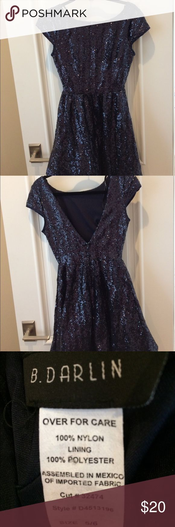 Navy Sequin Dress This dress is perfect for any special occasion! The sequins give it extra glam! Only worn once for homecoming! B. Darlin Dresses Prom