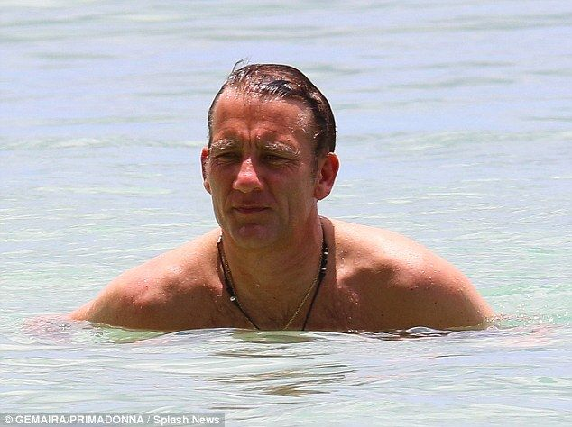 Chilling: British actor Clive Owen was seen enjoying a leisurely beach day in Barbados on Tuesday during a family holiday