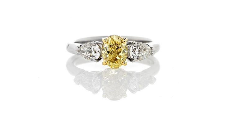 Fancy Canary Yellow Oval Diamond with White pear shape diamonds in white gold