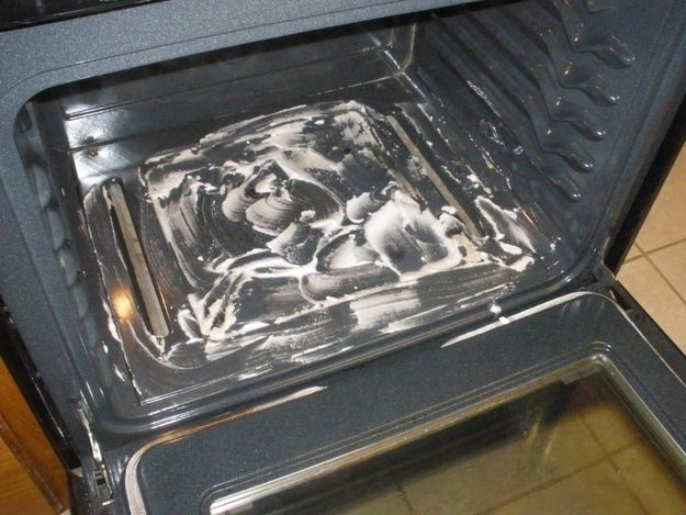 Scrub the inside of your stove with a baking soda-water paste.