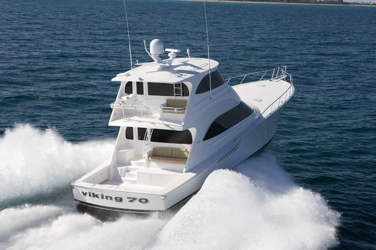 Viking sport fishing yacht with enclosed fly bridge.