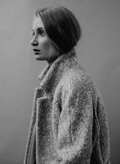 wool coat & tucked hair.