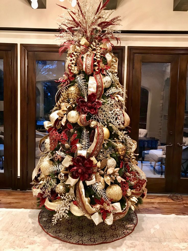 Elegant burgundy, champagne and gold Christmas tree designed by Arcadia Floral and Home Decor.