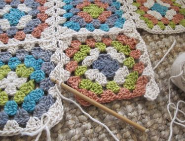 Step by step instructions on joining granny squares without sewing or leaving a seam.