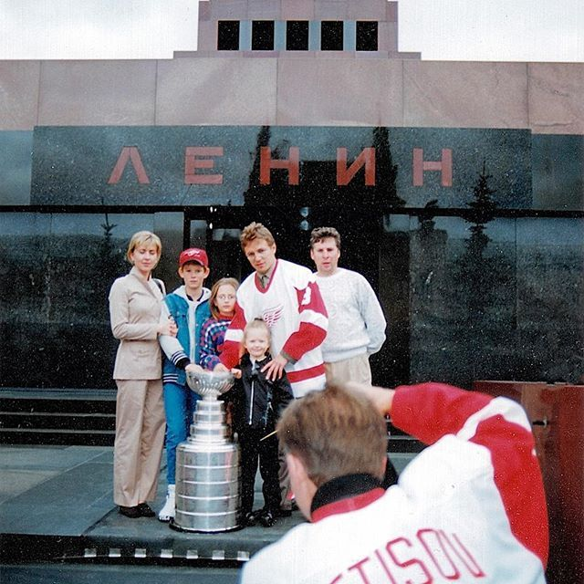 🇷🇺: Moscow, Russia 🗓: August, 1997 📷: Slava Fetisov 👩🏼: THE RED SQUARE PT. VI ▫️ During this time, we take a family photo in front of Lenin's Mausoleum with the Stanley Cup. ▫️ Pictured: My Mother, Uncle Fil, me, Diana, Igor, and his brother Evgeni. ▫️ Not pictured: Lenin's embalmed body. ▫️ I know that unlike everyone else, I have a desire to walk into Lenin's tomb. I remember feeling cold once entering the dark, marble-laden room. I was told to walk quietly and swiftly. To respect…