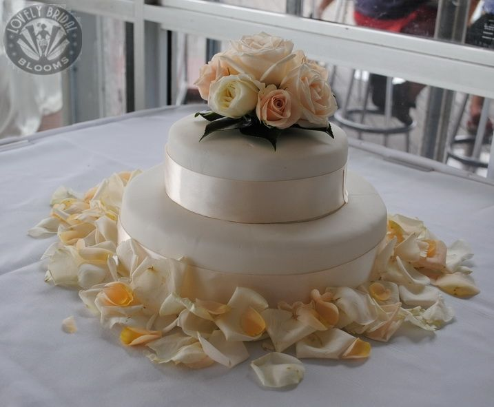 Small cake topper of pastel roses