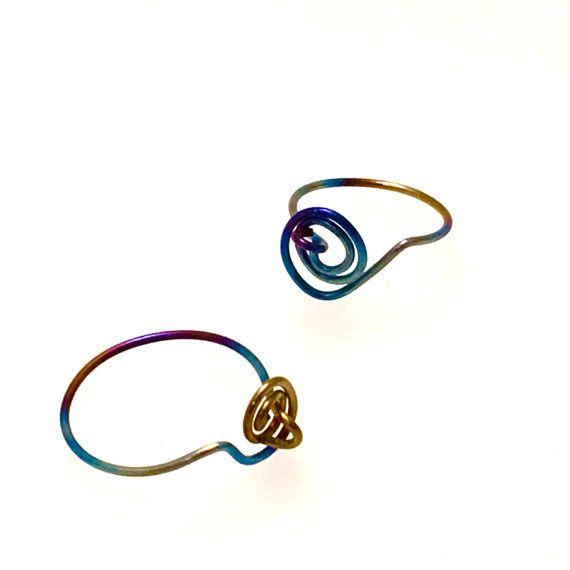 Titanium rainbow scroll ring by StudioContinuum on Etsy