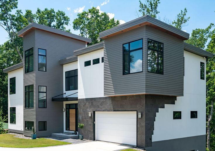 Fiber Cement A Textured Modern Fire Resistant Siding Option Siding Options House Siding Modern Architectural Styles