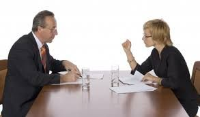 To confer - to discuss something with other people, so that everyone can express their opinions and decide on something