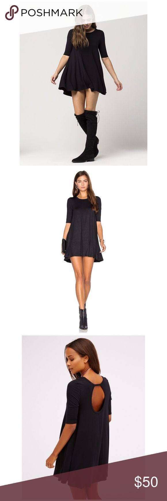 "Free People Black Tunic Free People Jacqueline tunic. A classic black tunic dress in a soft jersey knit. It features a wide crew neck with elbow sleeves. While demure in the front, the back has an open cutout for added flair. Approx length: 31"". 94% rayon/6% spandex. Hand wash. Free People Tops Tunics"
