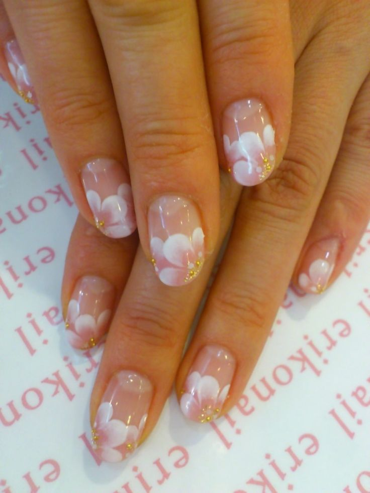Beautiful cherry blossom or sakura flower nails by erikonail