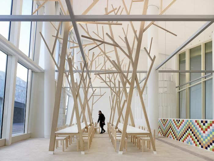 Remodelista, Estudio Nomada, Peter Eisenman, Cidade da Cultura de Galicia, abstract forest of trees extends from the dining room tables
