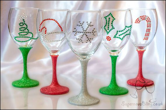 Hand made stunning wine glass decorated with glitter and rhinestones.  Christmas theme: Holly Leaf, Santa Hat, Snowflake, Candy Cone, Christmas